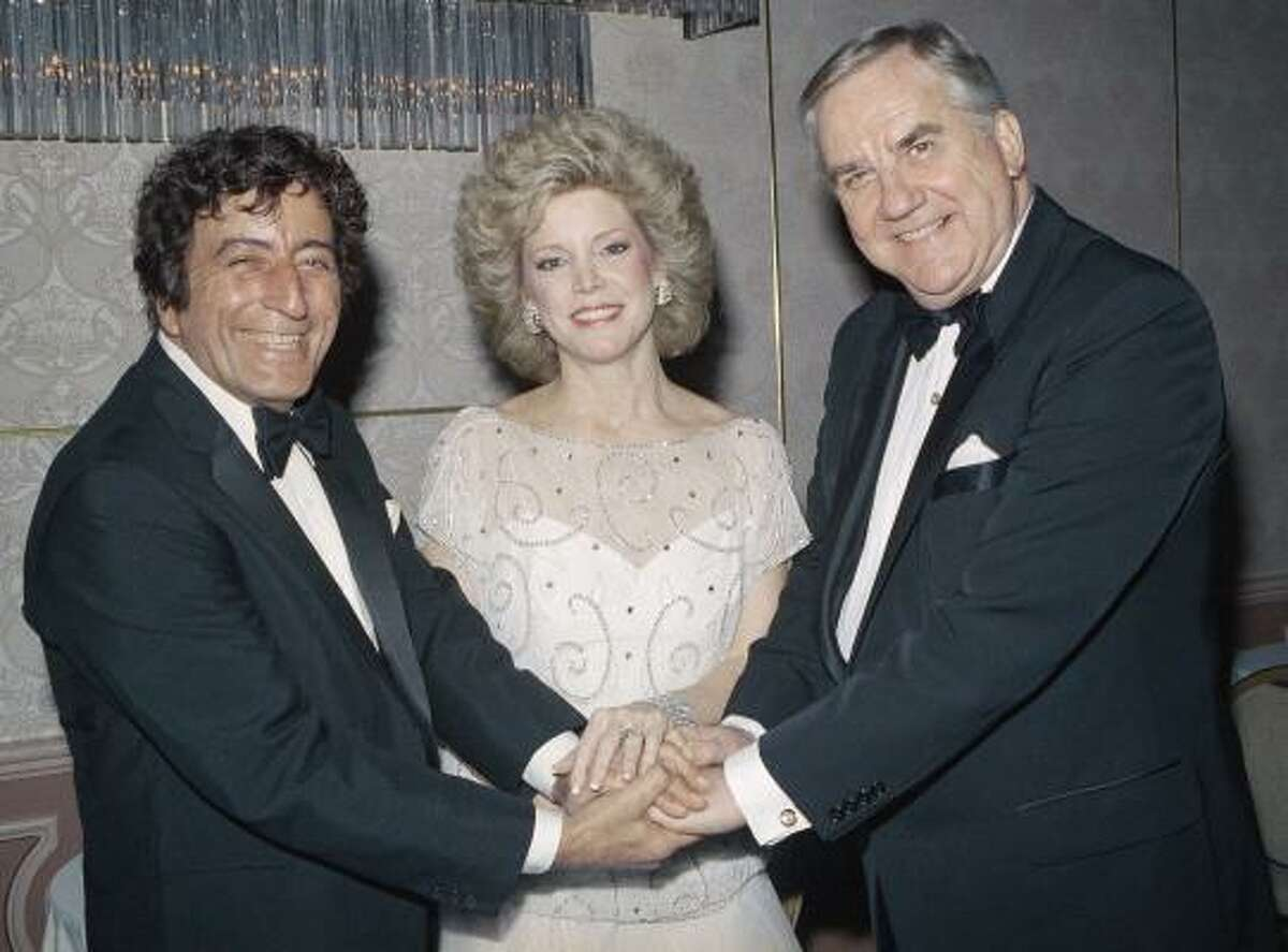 In this May 5, 1984 file photo, singer Tony Bennett, left, shakes hands with Victoria and Ed McMahon at the Beverly Hilton in Los Angeles after receiving a Humanitarian Award.