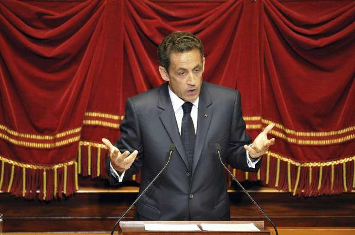 """French President Nicolas Sarkozy adresses parliament members at the Versailles palace of Paris, Monday,June 22, 2009. Sarkozy lashed out at the practice of wearing the Muslim burqa, insisting the full-body religious gown is a sign of the """"debasement"""" of women and that it won't be welcome in France."""