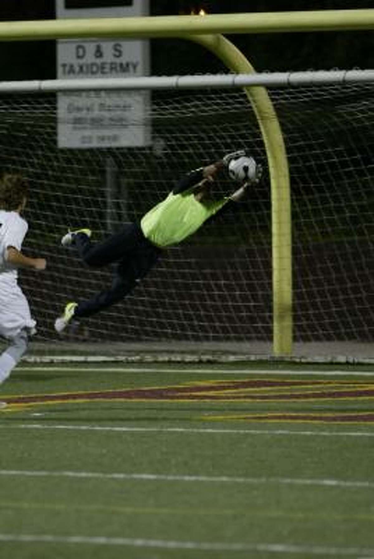 Texas City goalkeeper Chris Wright makes a diving save.