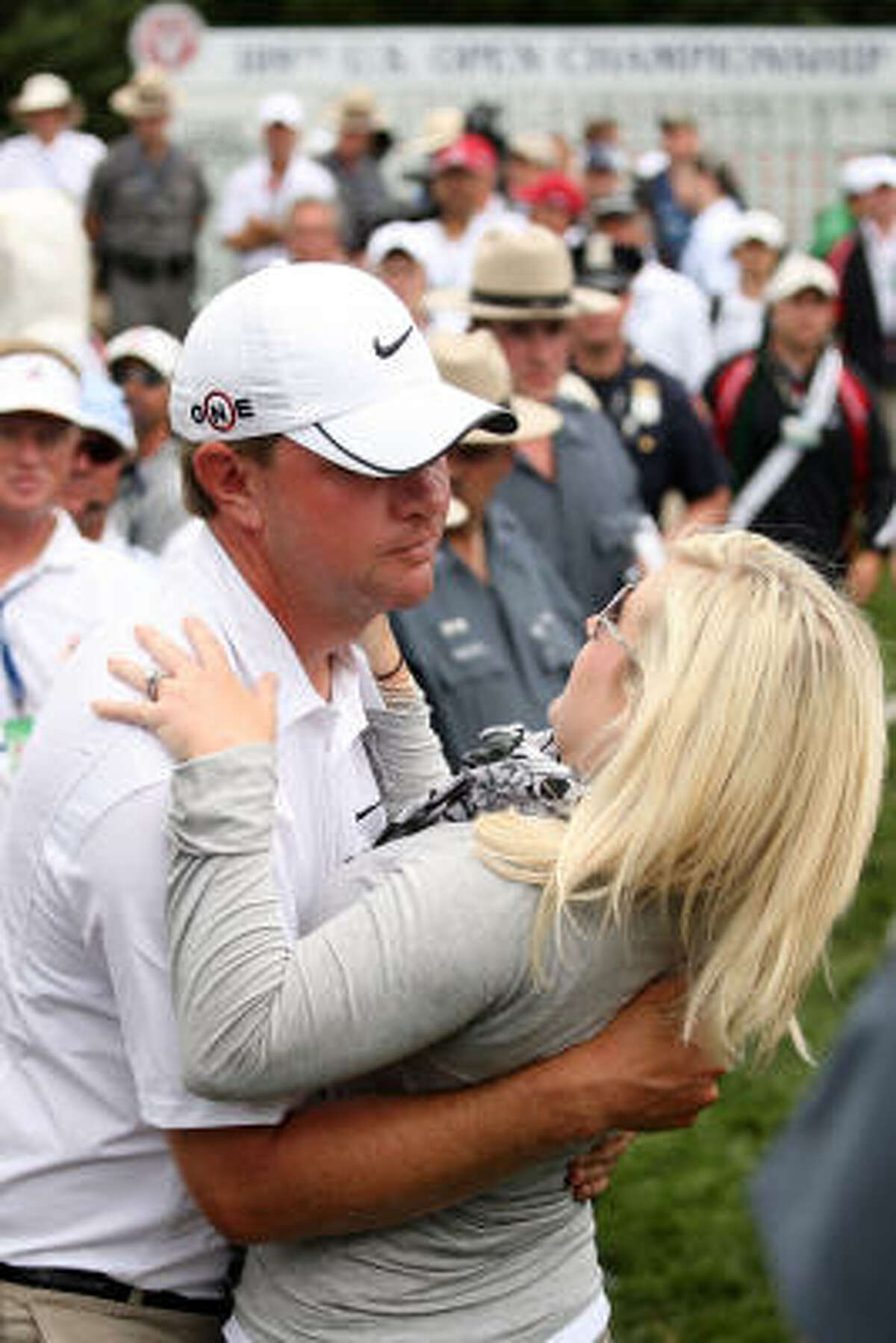 Lucas Glover celebrates his two-stroke victory with his wife, Jennifer, at the 109th U.S. Open.