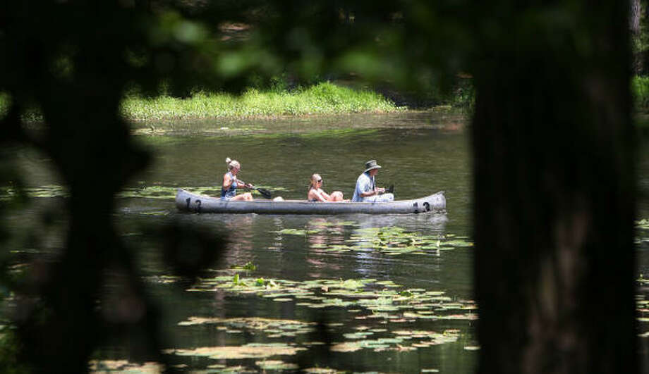 A family canoes together on the lake at Huntsville State Park.  Photo: Mayra Beltran, Houston Chronicle