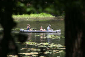 A family canoes together on the lake recently at Huntsville State Park. The Texas Parks and Wildlife Department reports overnight stays in state parks that allow camping were up 69 percent this Memorial Day weekend, compared with the 2008 holiday.
