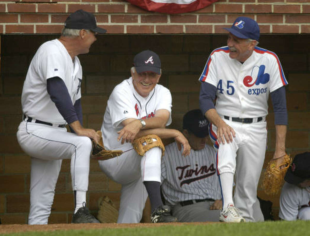 Johnny Grubb, Phil Niekro and Steve Rogers, from left, laugh from the dugout.
