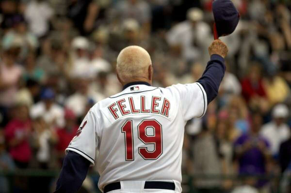Hall of Famer Bob Feller, 90, acknowledges the fans during introductions before the Baseball Hall of Fame Classic.