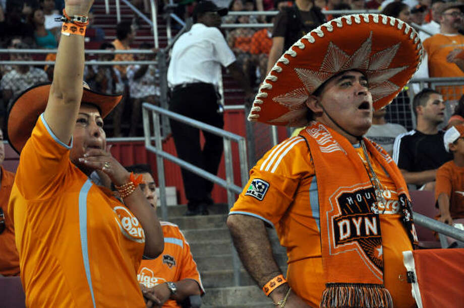 Dynamo super fans Bandida and Bandido heckle Real Salt Lake players as the leave the field. Photo: Chris Elliott, For The Chronicle