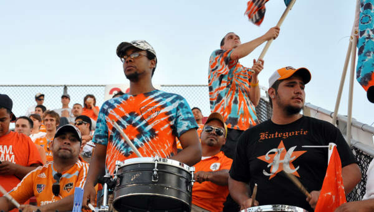 Drums and flags are part of the fan culture at Dynamo games.