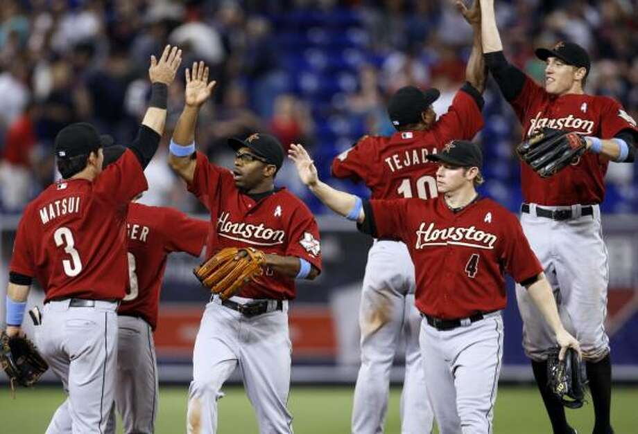 Astros 4, Twins 1Kaz Matsui (3), Michael Bourn (wearing eyeglasses), Jason Michaels (4), Miguel Tejada (10) and Hunter Pence, right, celebrate after beating the Twins 4-1 on Sunday. Photo: Ann Heisenfelt, AP