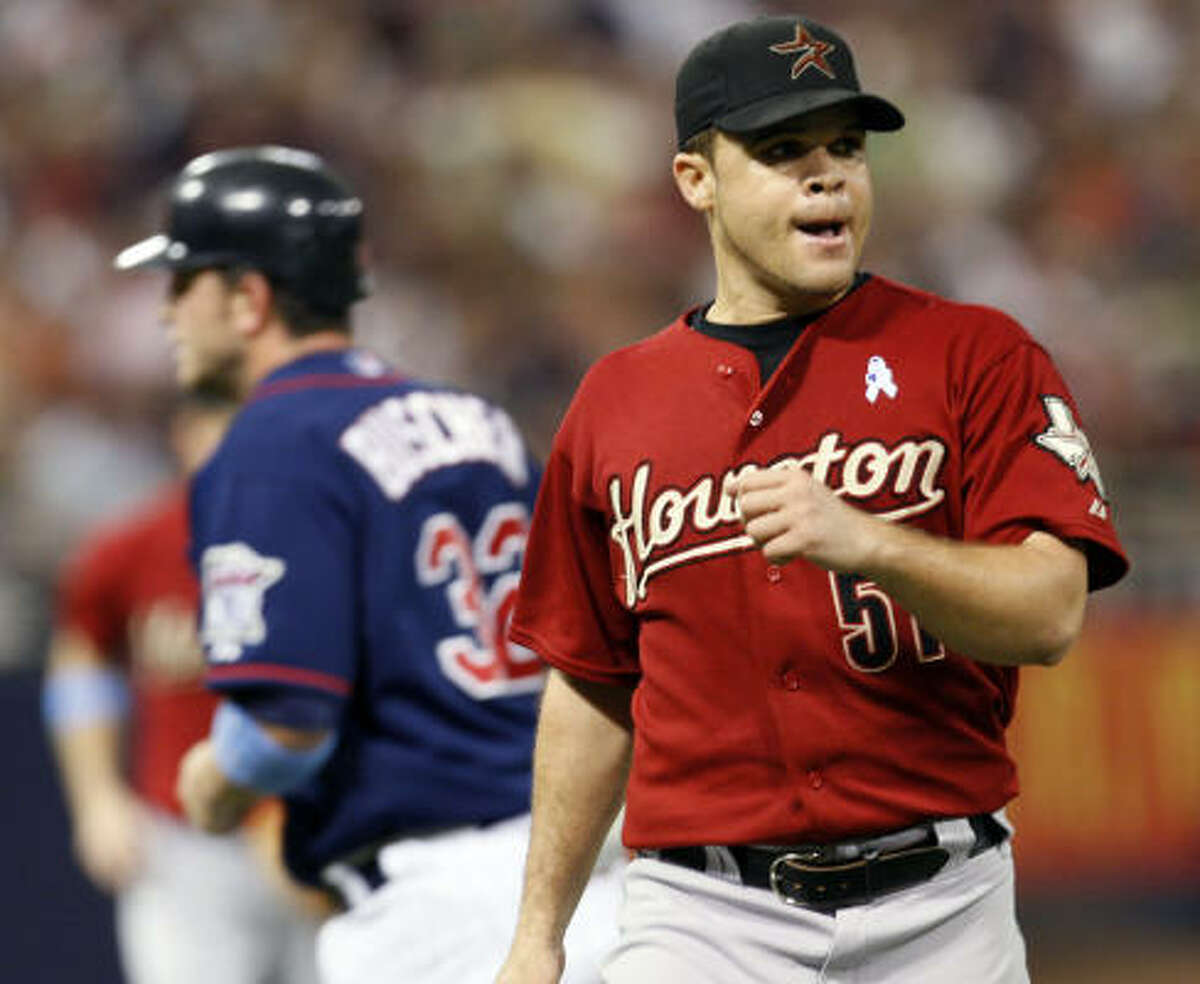 Astros pitcher Wandy Rodriguez celebrates after his teammates turned a double play to end the seventh inning.