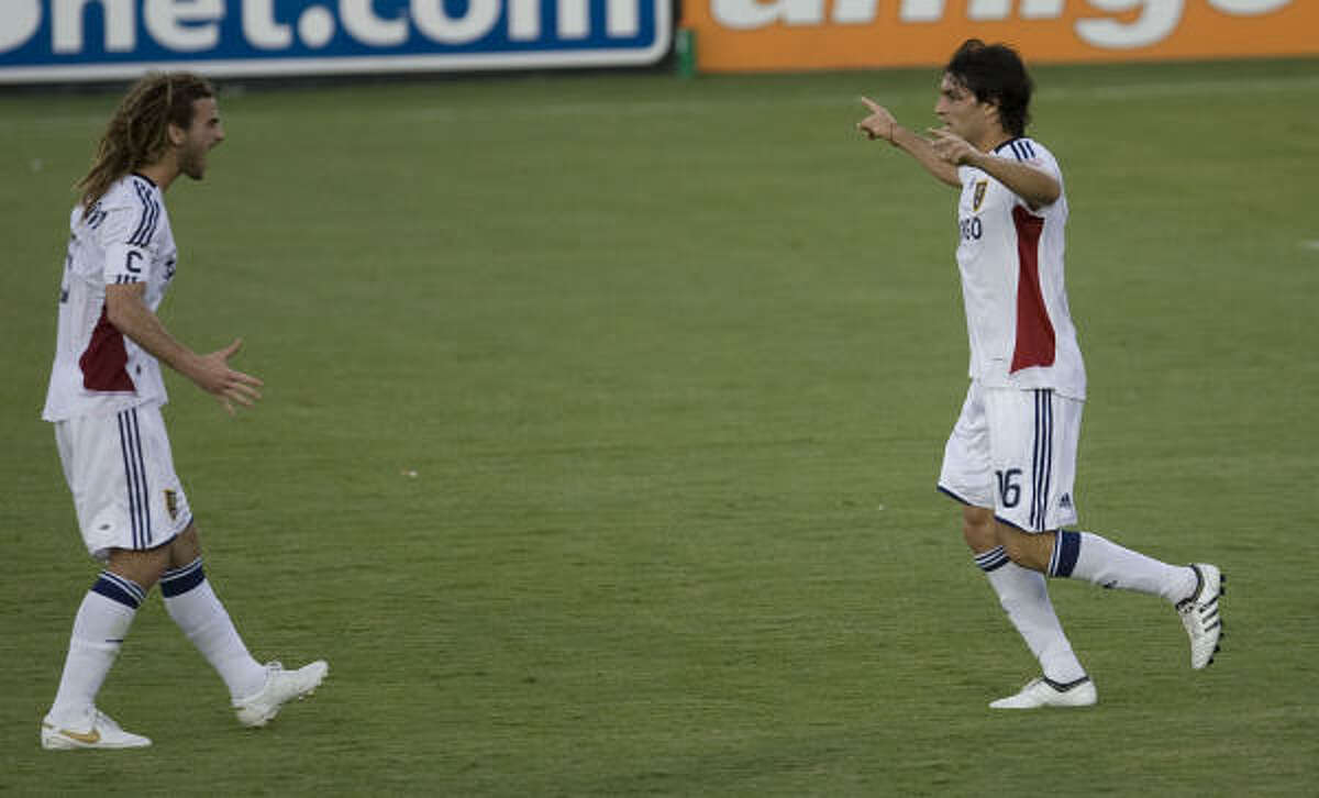 The Real Salt Lake's Fabien Espindola (right) celebrates with teammate Kyle Beckerman (left) after scoring a goal against the Houston Dynamo.