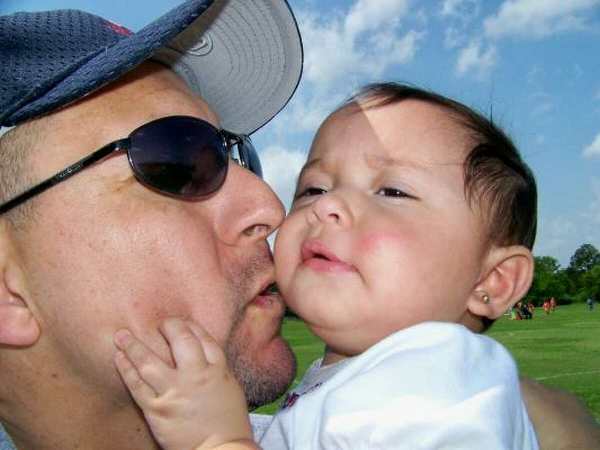 my husband and our Ava Rose, 10mos old.