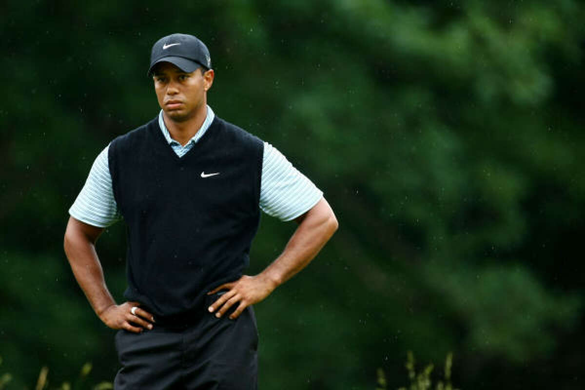 Tiger Woods waits on the ninth hole during the continuation of the second round.