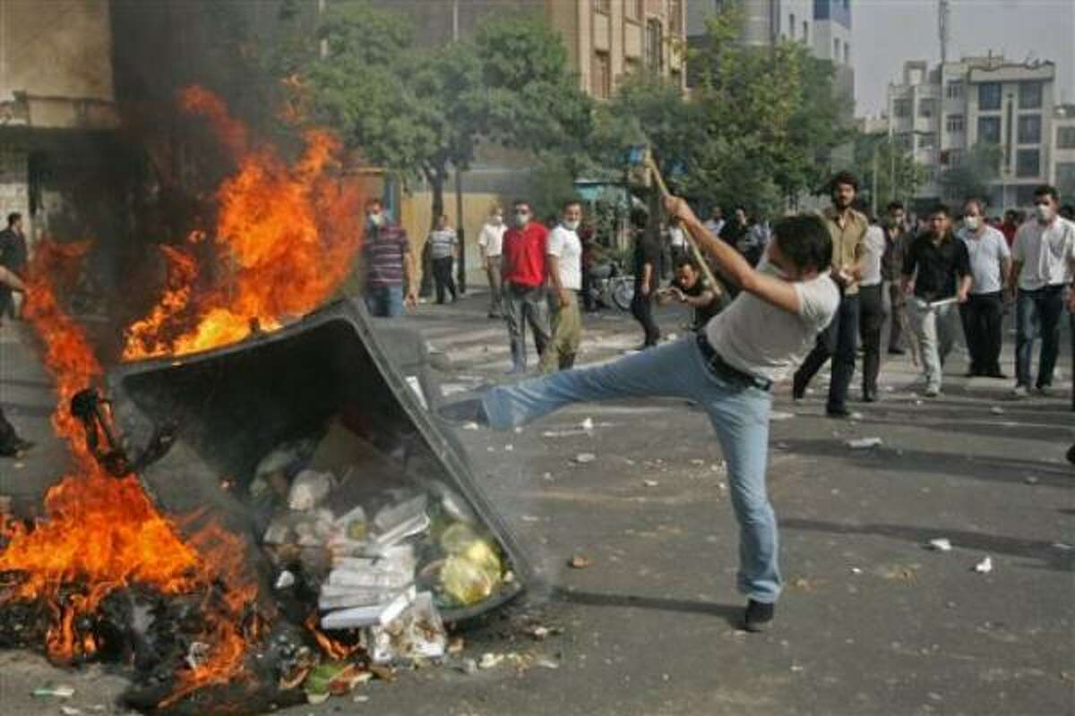 Eyewitnesses described fierce clashes after some 3,000 protesters chanted near Revolution Square in downtown Tehran.