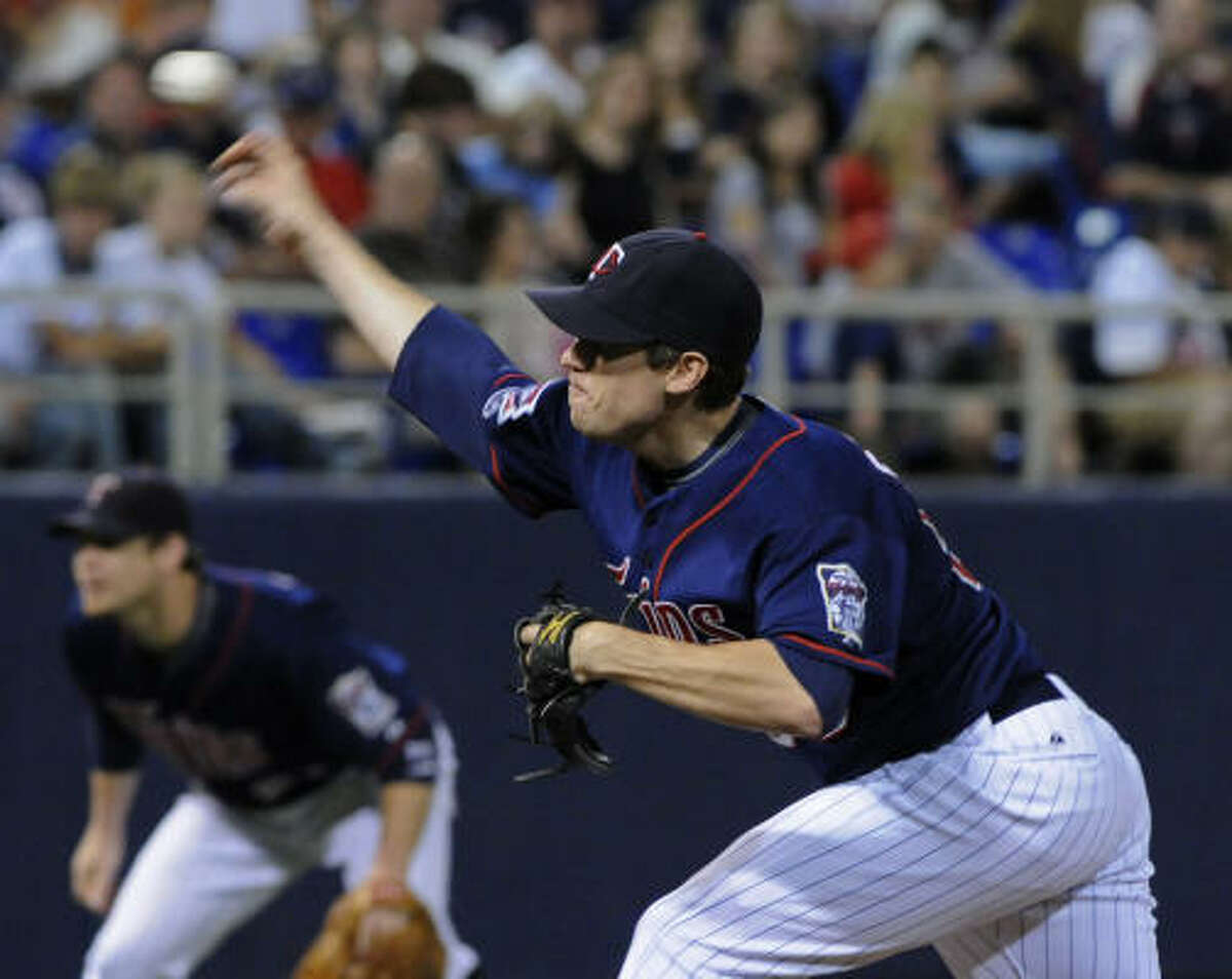 Minnesota Twins' Kevin Slowey pitches against the Houston Astros in the first inning.