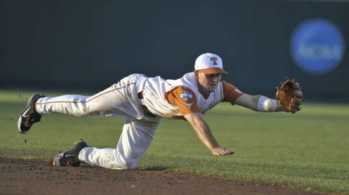 Texas second baseman Travis Tucker can't get to a ball hit by ASU's Matt Newman in the first inning.