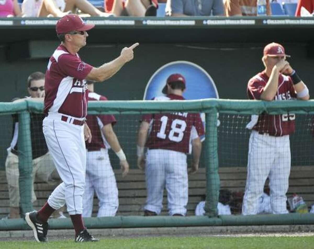 Arkansas coach Dave Van Horn calls for pitcher Sam Murphy during the seventh inning.
