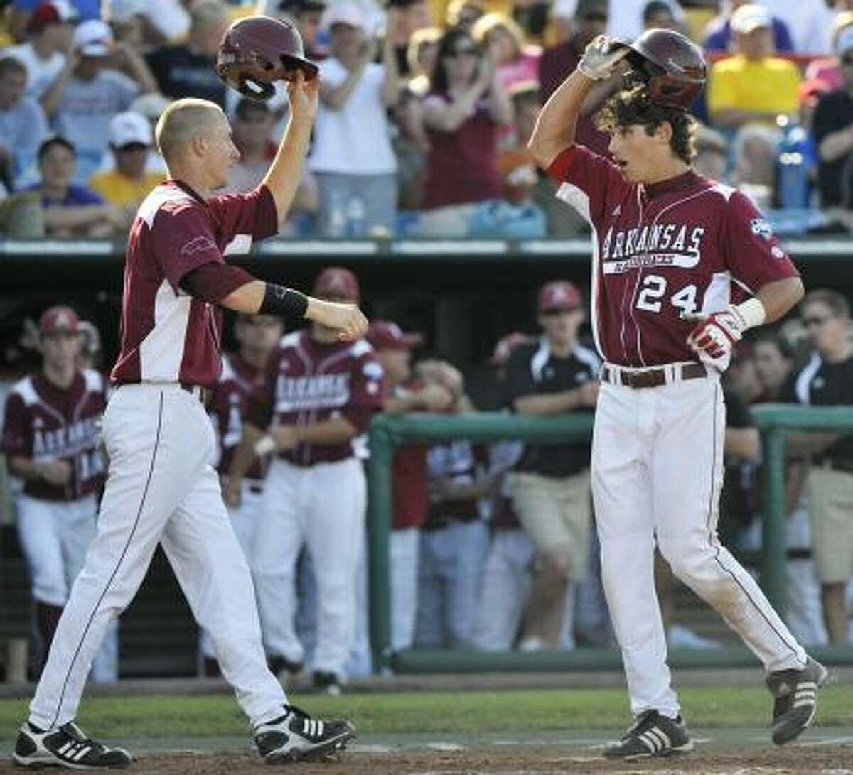 Arkansas' Brett Eibner, right, and Jacob House celebrate at home plate after Eibner hit a two-run homer against LSU during the seventh inning.