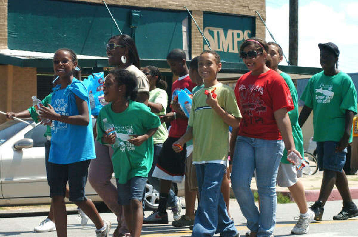 Children march with the Kappa Alpha Psi Fraternity in Galveston's Juneteenth parade.
