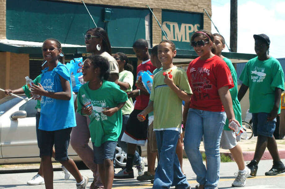 Children march with the Kappa Alpha Psi Fraternity in Galveston's Juneteenth parade. Photo: Kirk Sides, For The Chronicle