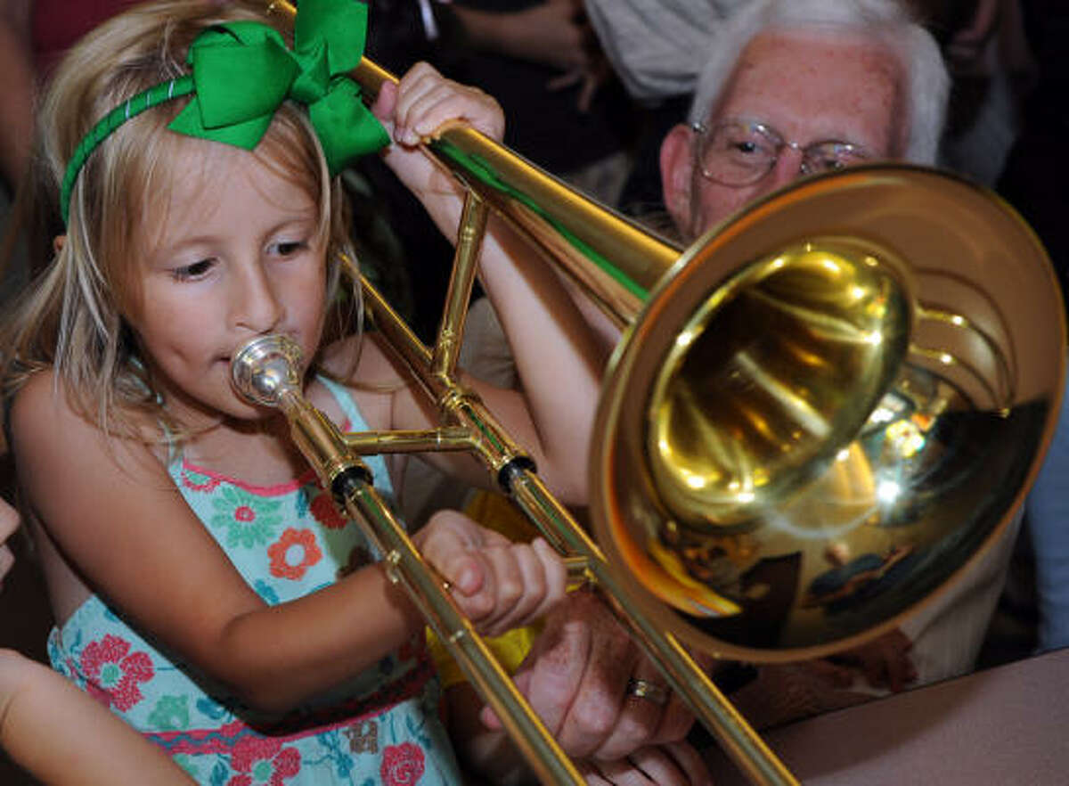 Abby Stovall, 6, tries out at a trombone before the Houston Symphony's free Sounds Like Fun concert at St. Bernadette Church in Clear Lake over the weekend.