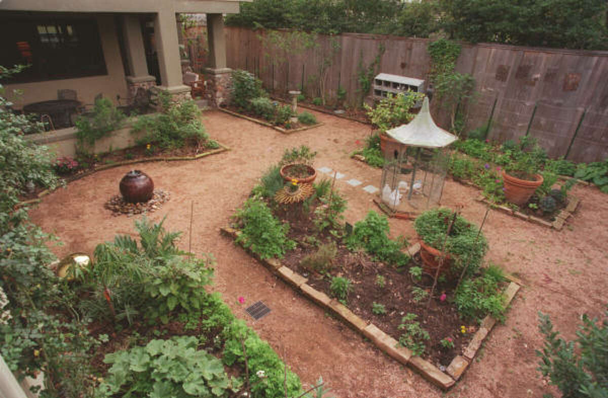 Vegetables and herbs -- and a chicken coop -- fill this Houston garden.