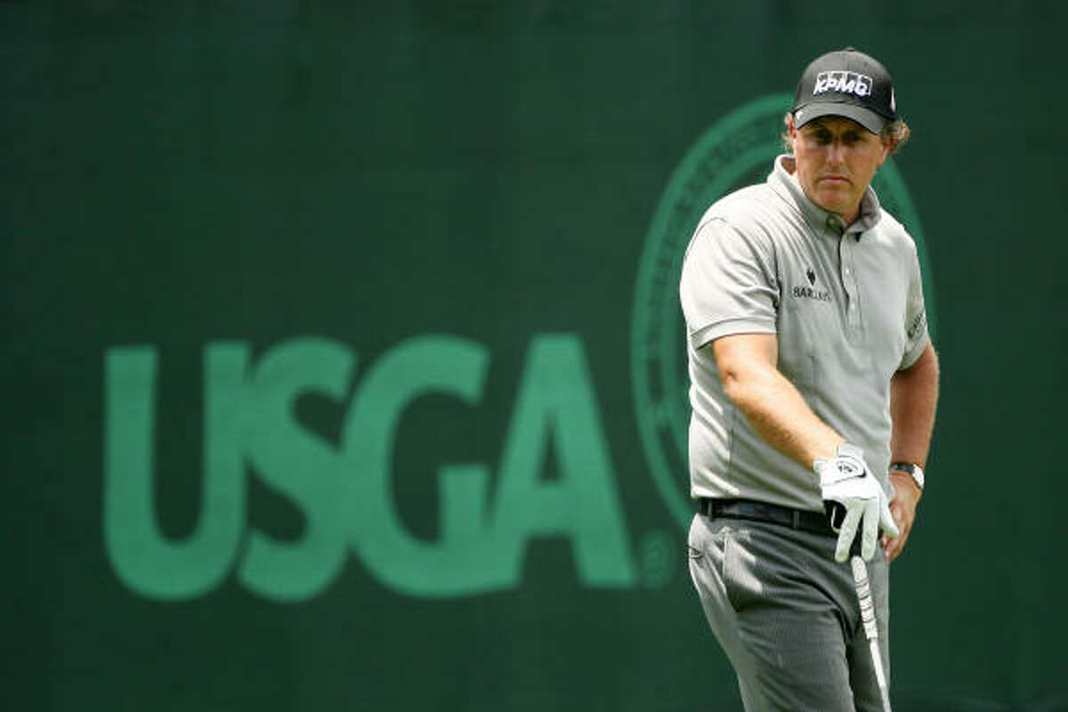 Phil Mickelson waits to tee off on No. 15 during the continuation of the first round of the 109th U.S. Open on the Black Course at Bethpage State Park.