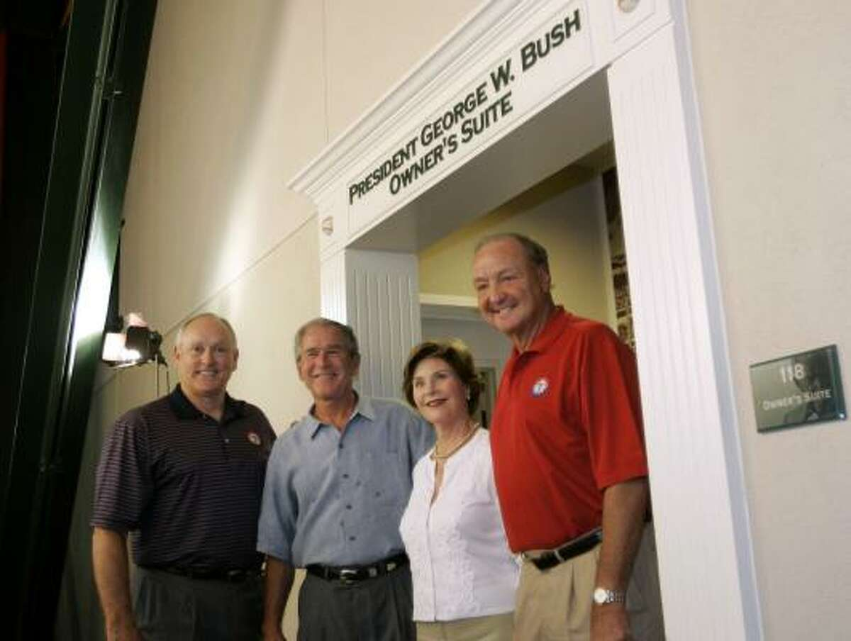 Rangers president Nolan Ryan, left, former President George W. Bush, Laura Bush and team owner Thomas Hicks stand in front of the owner's suite that was renamed for the former president in a pregame ceremony.