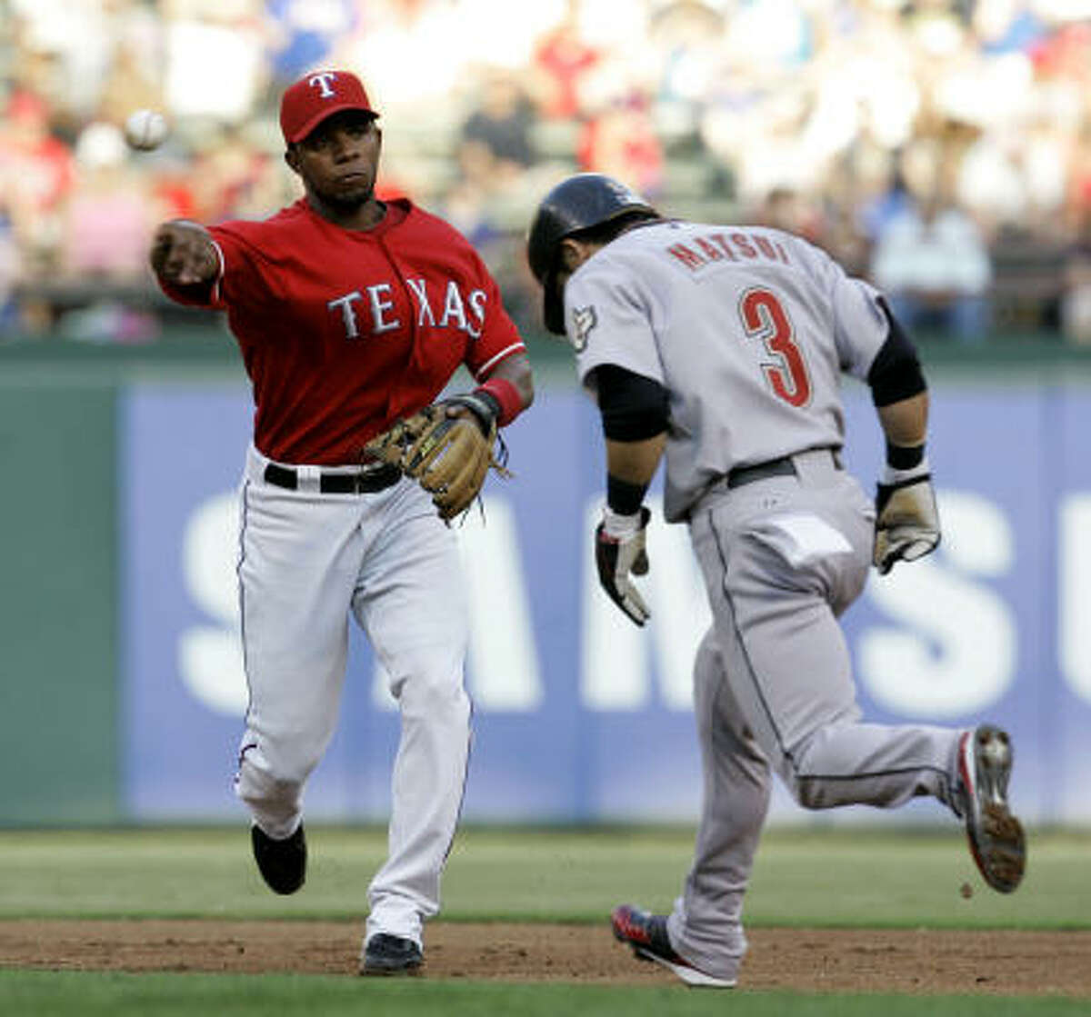 Rangers shortstop Elvis Andrus forces out Houston's Kazuo Matsui and throws to first for the double play in the second inning.