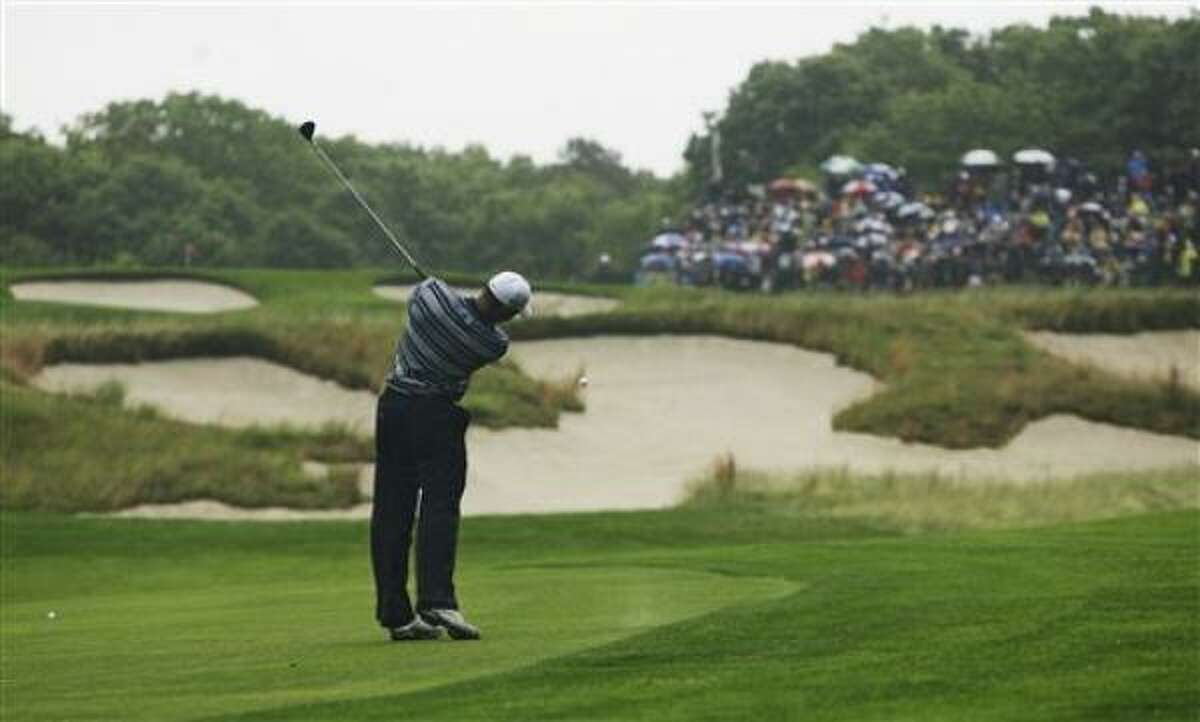Defending U.S. Open champion Tiger Woods drives on the second hole.