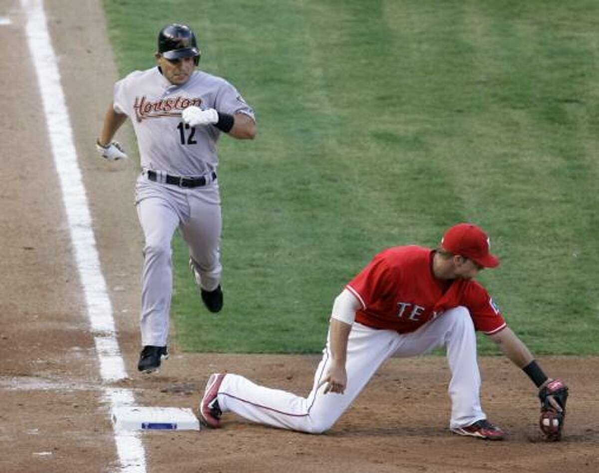 Houston's Ivan Rodriguez is out at first base on a grounder to third as Texas' Chris Davis grabs the throw.