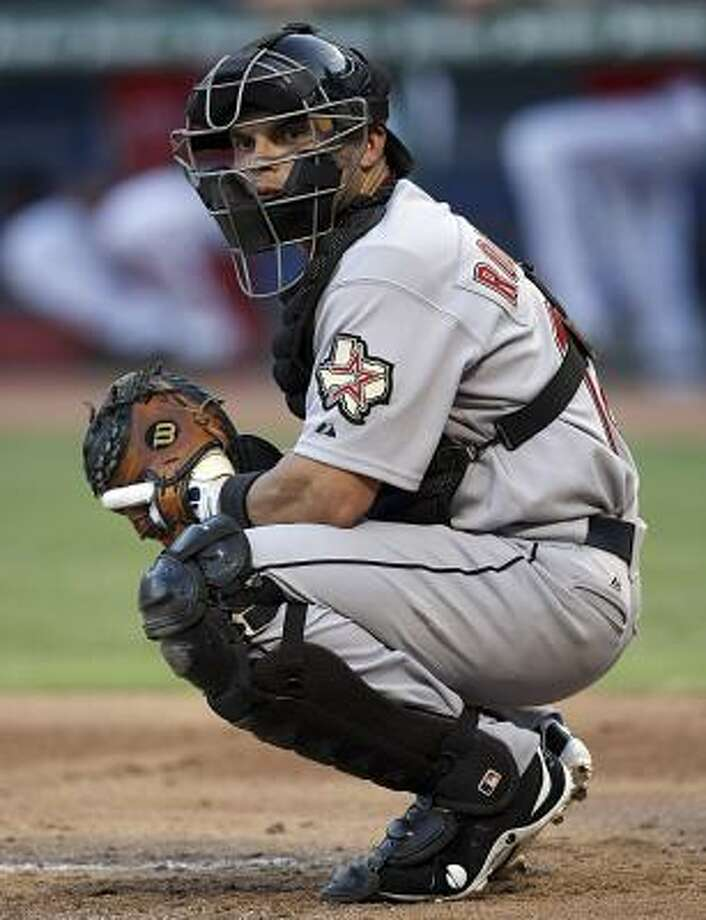 Astros catcher Ivan Rodriguez looks to the dugout in the bottom of the second inning of his 2,226th career game caught, which ties Carlton Fisk's major league record. Photo: Tom Pennington, AP