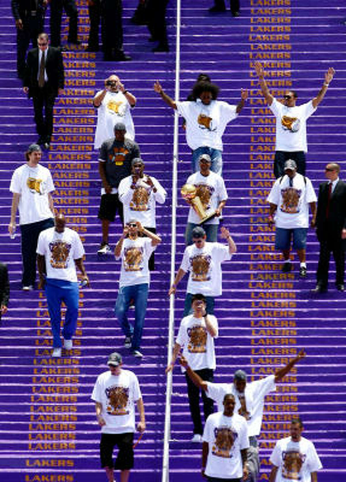 Members of the Los Angeles Lakers walk down the steps during the 2009 NBA Championship Victory Parade at the Los Angeles Memorial Coliseum