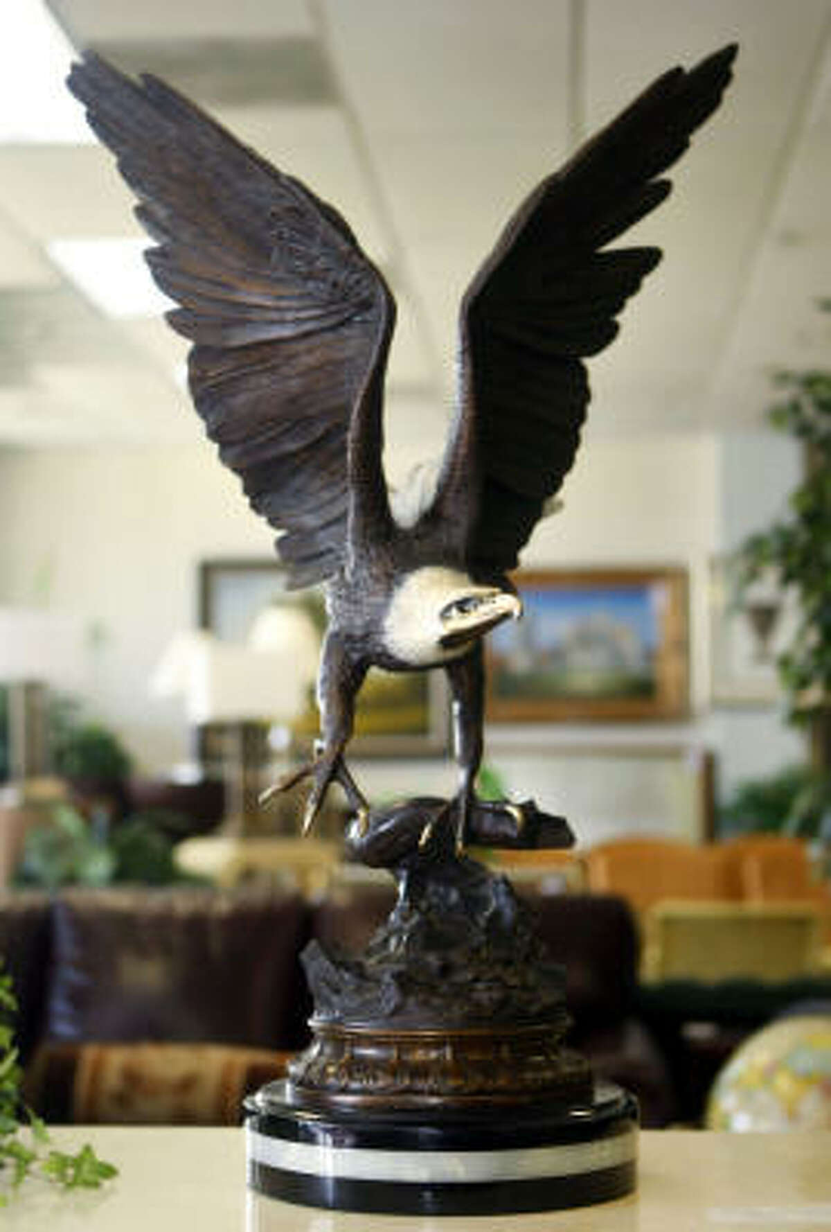 This bronze eagle sculpture on a marble base is going for $999.