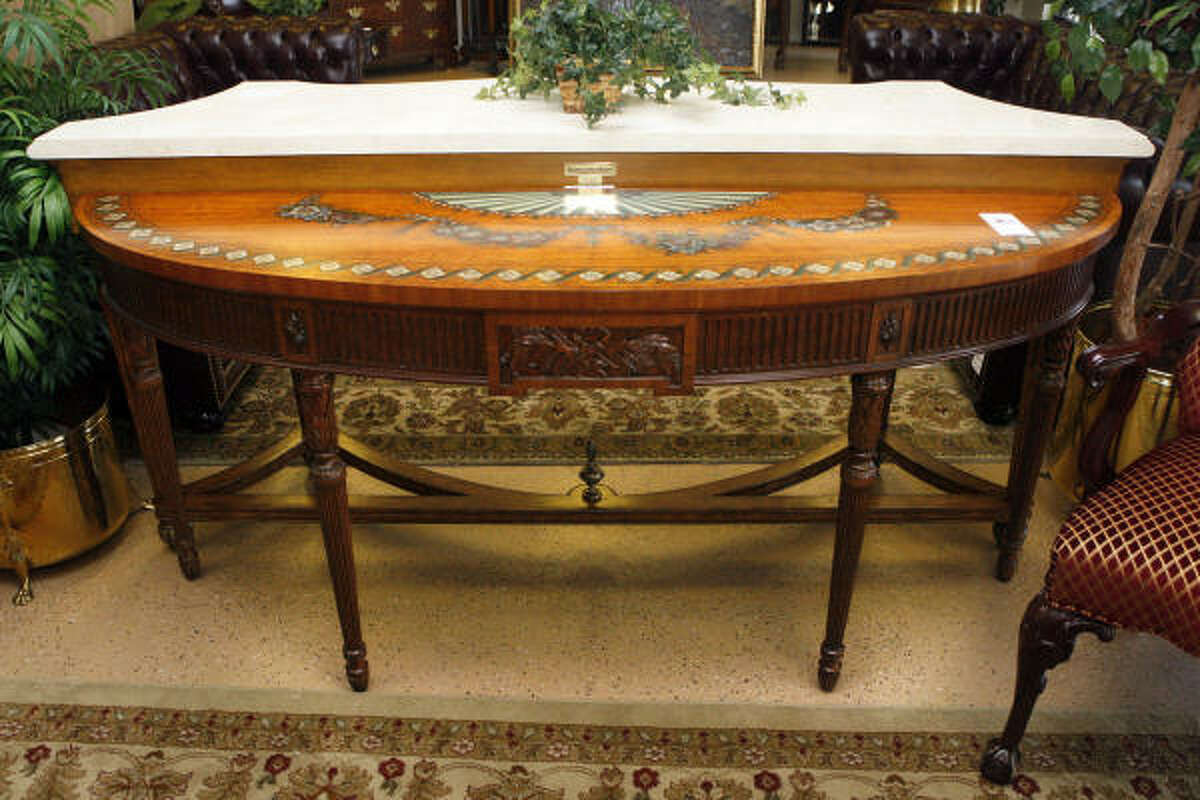 "This half-moon table is priced at $1,200. ""The quality of this stuff is just really nice,"" one shopper said Tuesday."