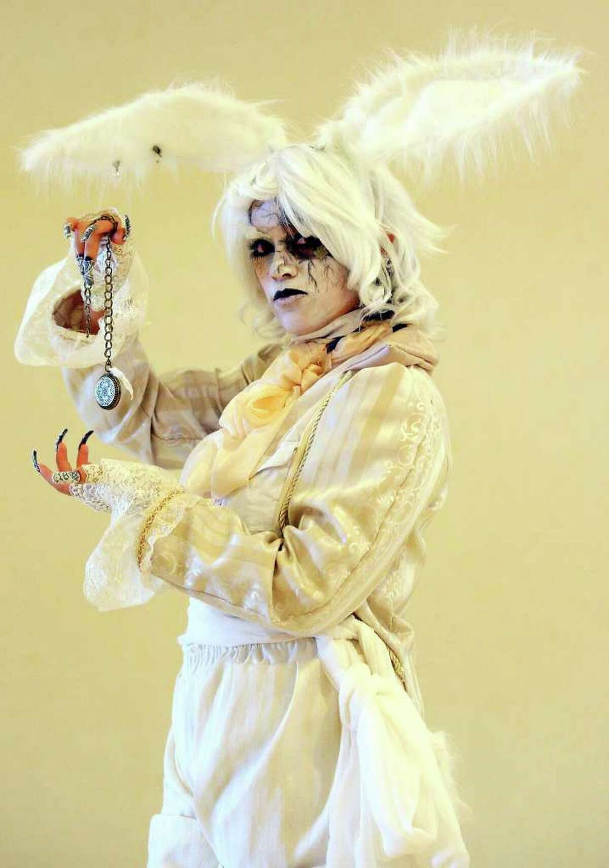 """Natalie Hoo, 23, as the """"White Rabbit"""" poses for a photo while attending the San Japan 4TW convention Saturday Aug. 6, 2011 at the Marriott Rivercenter. San Japan 4TW runs Aug. 5-Aug. 7th."""