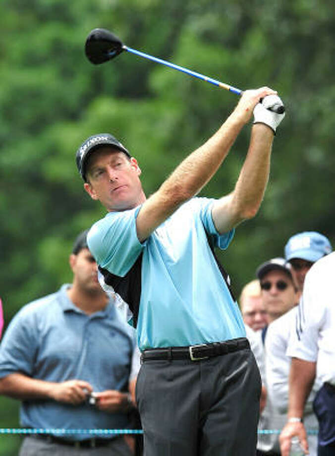 Jim Furyk tees off on the second hole during a practice round for the U.S. Open on Tuesday. Photo: Kathy Kmonicek, MCT