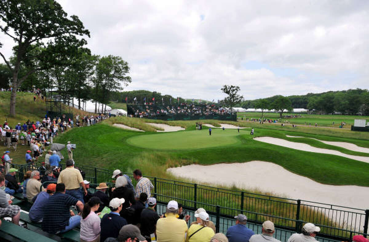 Fans watch a practice round from stands at Bethpage Black in Farmingdale, New York.