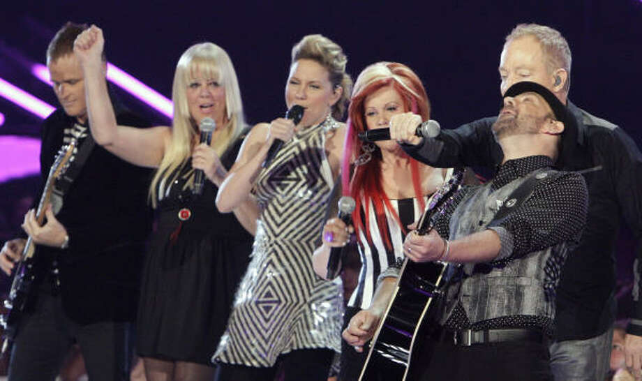 Sugarland and the B-52s perform the latter's Love Shack at Tuesday's Country Music Television Awards. Sugarland also won Duo of the Year for their island-themed video All I Want to Do. Photo: Mark Humphrey, AP