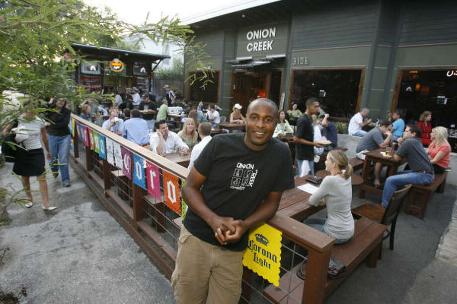 Onion Creek, 3106 White Oak in the Heights,  brings the Austin culture to Houston in the form of food and fun. Photo: BEN DESOTO, Houston Chronicle