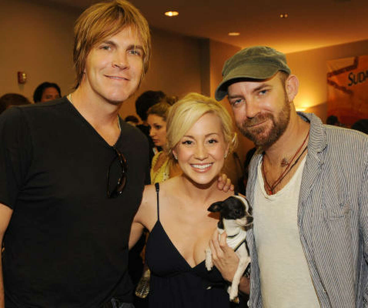That's Jack Ingram, Kellie Pickler with her dog Moo Moo, and Kristian Bush of Sugarland backstage during rehearsals for the 2009 CMT Music Awards June 15 in Nashville.