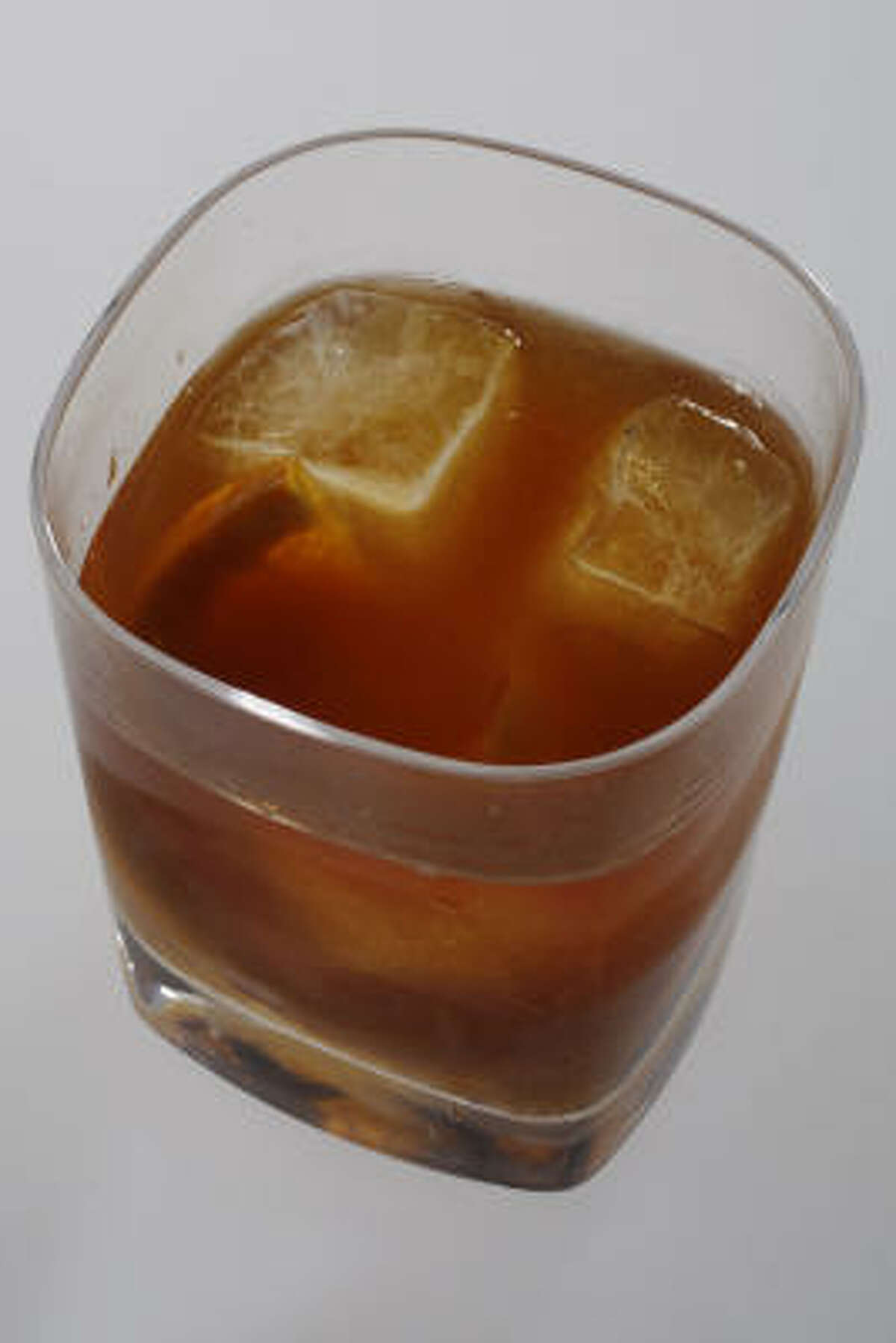 Old-Fashioned: You'll need to know how to make a great old-fashioned if you want to impress your boss when you have her over for dinner. 1 sugar cube; 3 to 5 to 7 dashes Angostura bitters; 1 Luxardo maraschino cherry; 1 half-wheel orange; 3 ounces bourbon or straight rye whiskey. Muddle the sugar, bitters, cherry and orange in an old-fashioned glass. Add ice and the whiskey. Stir briefly, for about five seconds. Makes 1 drink.