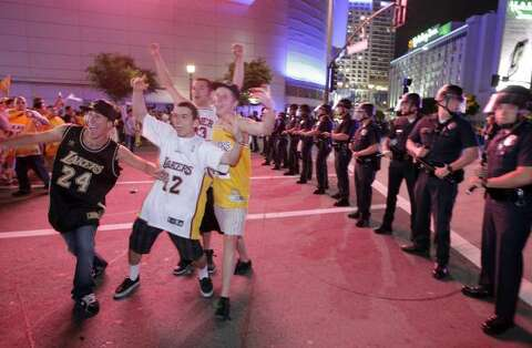the best attitude f1261 77ae4 Lakers fans celebrate the Lakers  win the NBA championships as they stand  near police officers