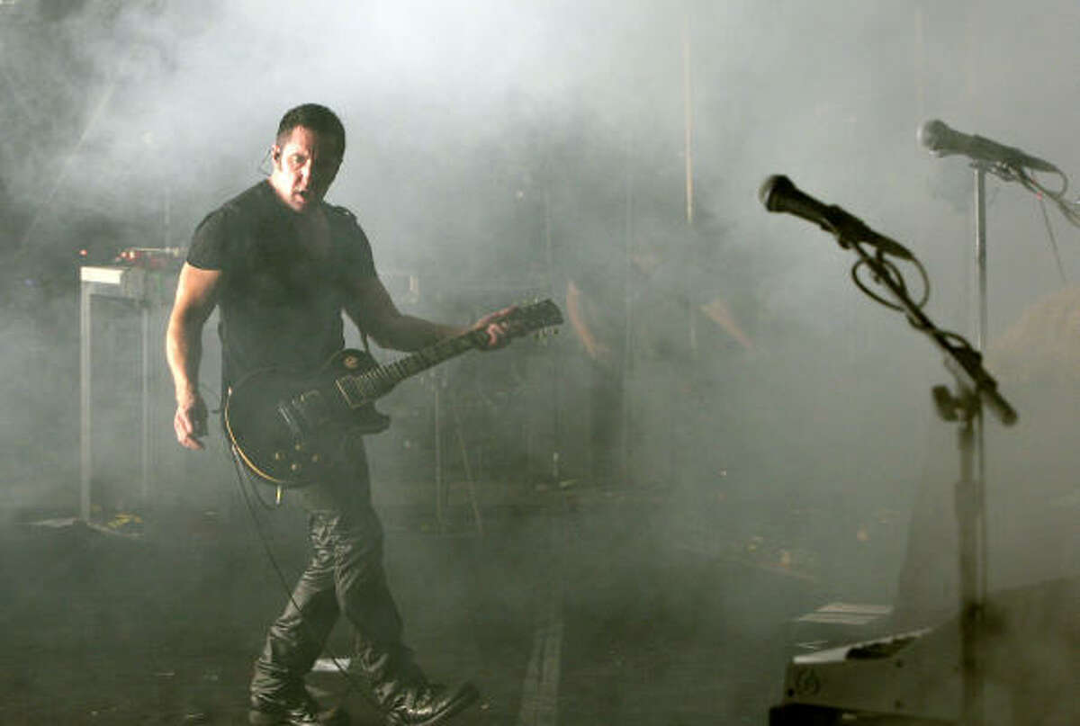 MANCHESTER, TN - JUNE 13: Trent Reznor of Nine Inch Nails performs on stage during the 2009 Bonnaroo Music and Arts Festival on June 13, 2009 in Manchester, Tennessee.