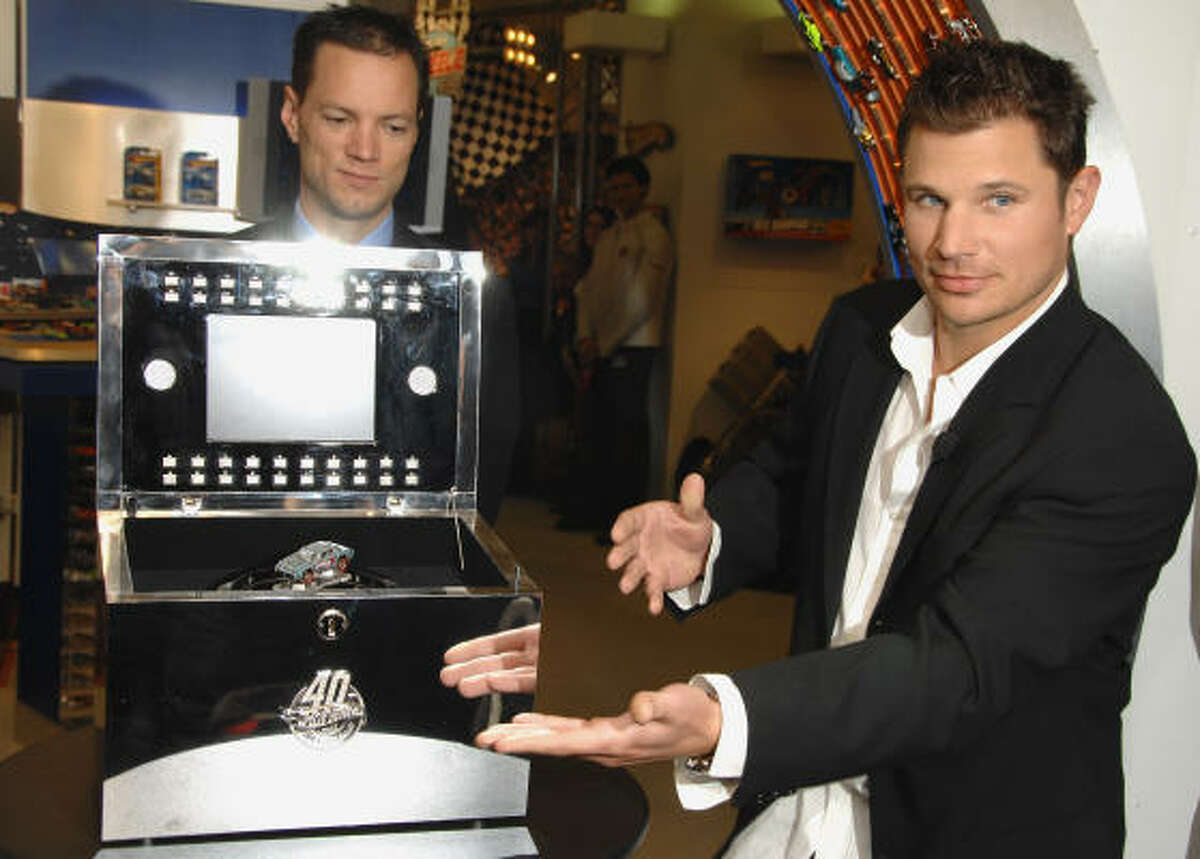 Singer Nick Lachey, right, and Geoff Walker, vice president of Hot Wheels Marketing participate in Hot Wheels' 40th anniversary kick off with an unveiling of a diamond-encrusted car at the New York Toy Fair, Friday, Feb. 15, 2008 in New York. The one of a kind 18-karat white gold jeweled car is valued at $140,000 with 2,700 diamonds weighing nearly 23 carats in total weight.
