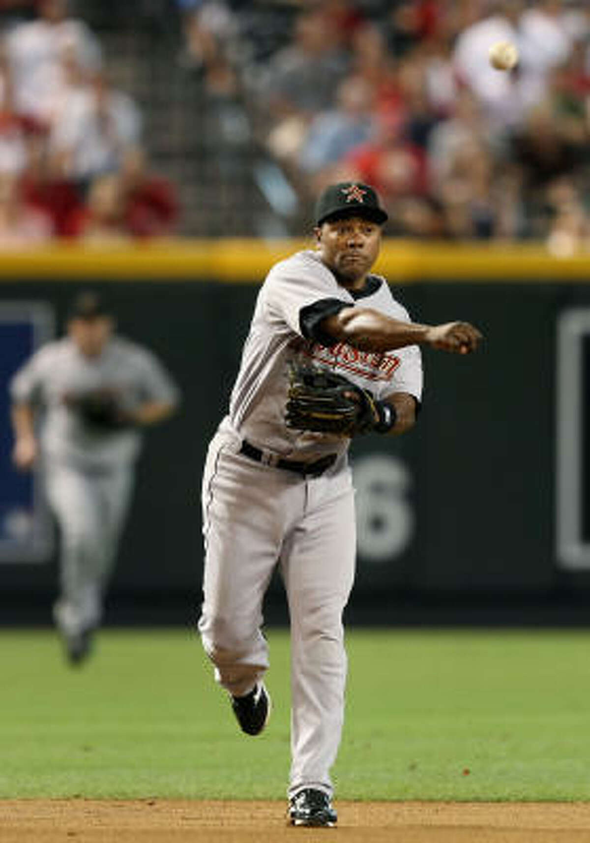 Shortstop Miguel Tejada fields a ground ball against the Arizona Diamondbacks.
