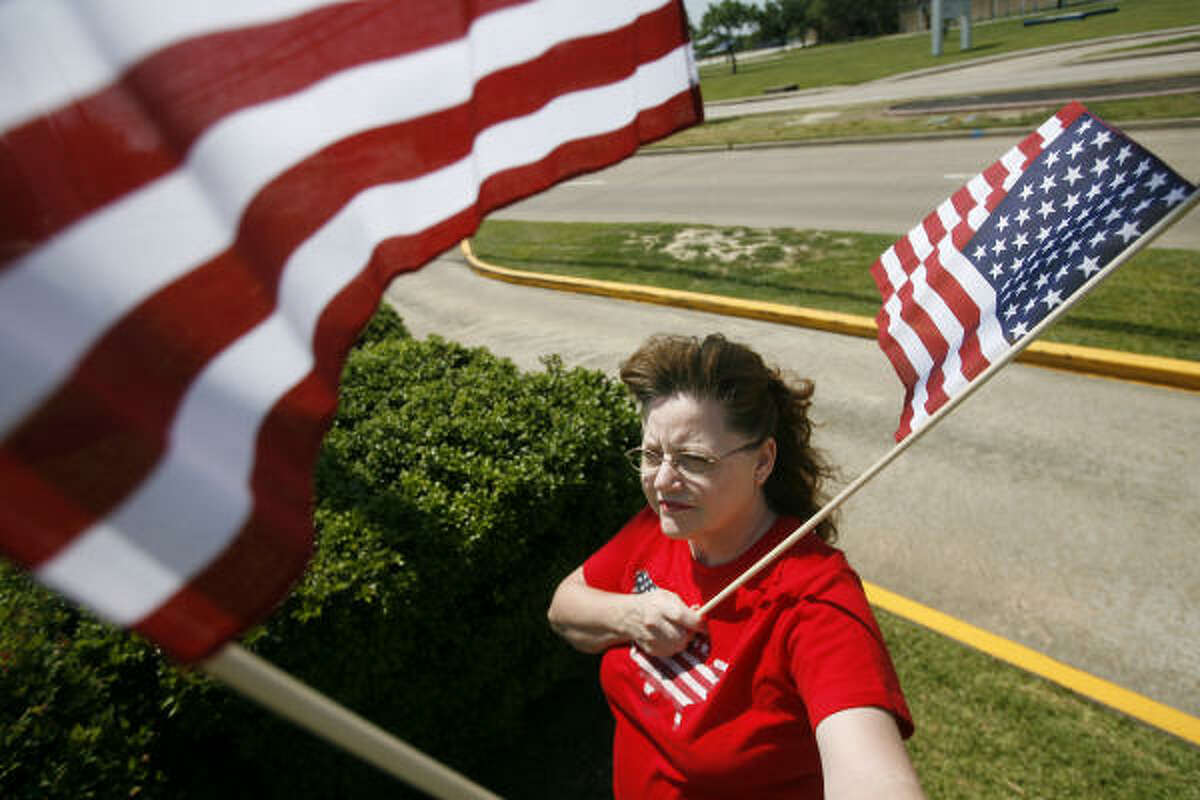 Sandy Allen, a teacher in Baytown, participates in a Flag Day rally.