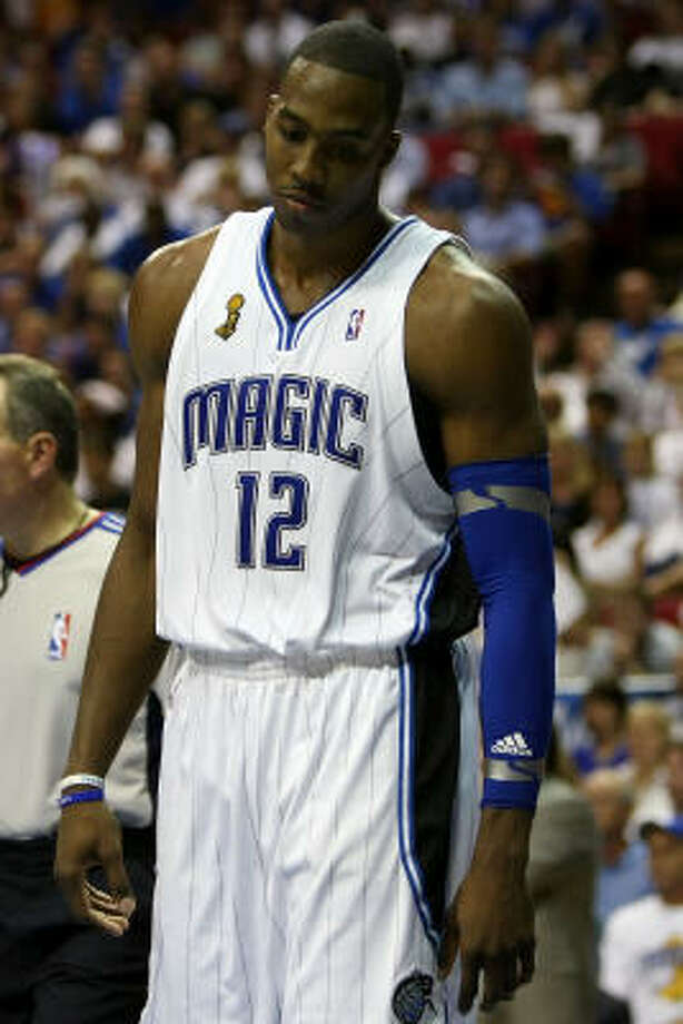 Game 5: Los Angeles Lakers 99, Orlando Magic 86Dwight Howard of the Orlando Magic looks down in the fourth quarter as the Magic trail the Los Angeles Lakers. Photo: Elsa, Getty Images