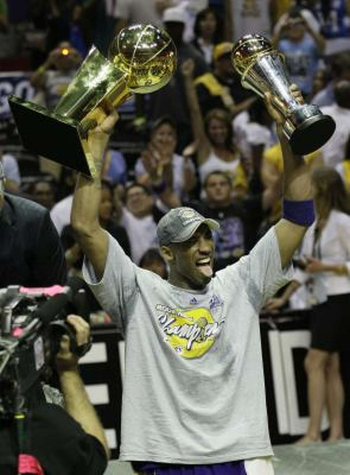 Game 5: Los Angeles Lakers 99, Orlando Magic 86 Los Angeles Lakers' Kobe Bryant holds the championship trophy and Finals MVP trophy after the Lakers beat the Orlando Magic.