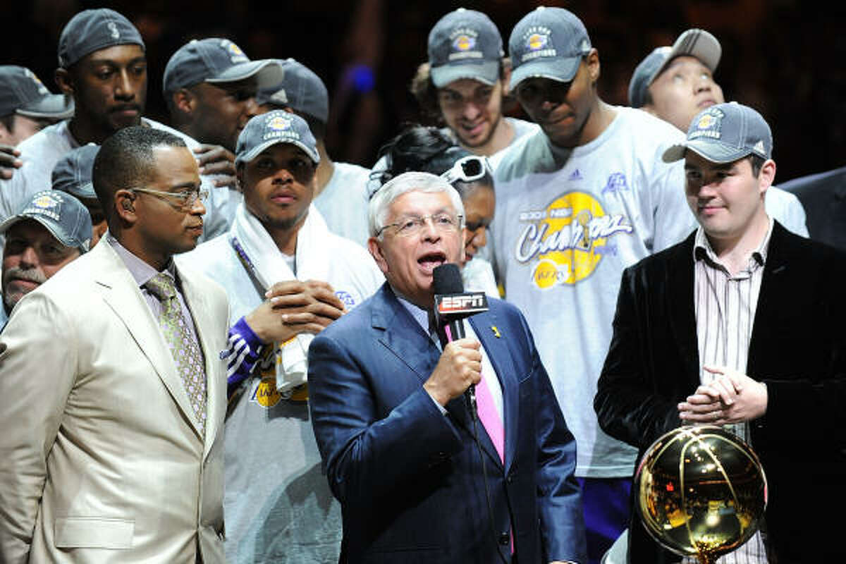 Game 5: Los Angeles Lakers 99, Orlando Magic 86 NBA Commissioner David Stern hands out the Larry O' Brien Trophy to the Los Angeles Lakers.