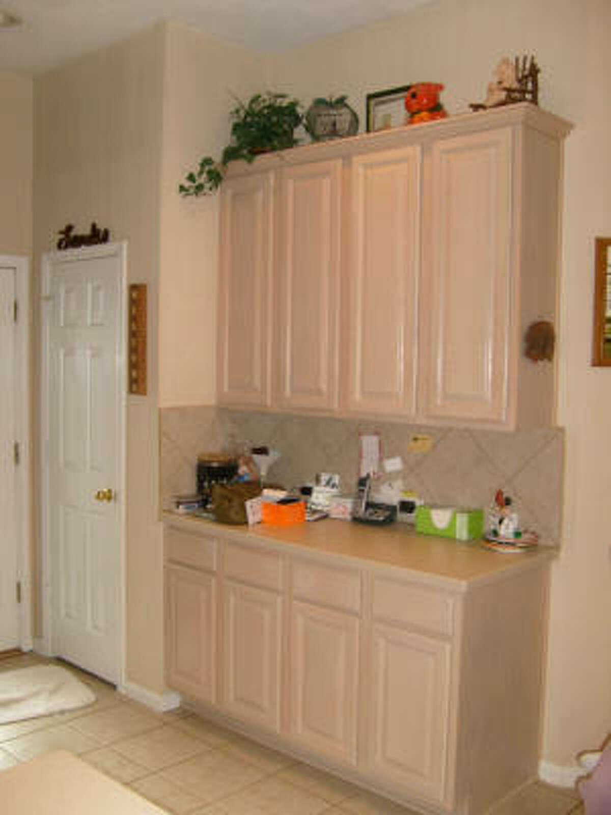 Hutch in a before kitchen that interior designer Carla Aston worked on.