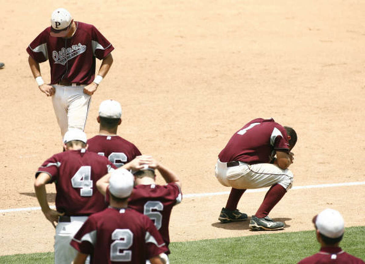Pearland falls in semifinal thriller: Pearland players react to an extra inning two-run homer by Lufkin's Luis Dejesus in the UIL 5A state baseball semifinal in Round Rock, Texas Friday June 12. Pearland lost 4-2.